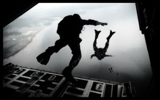 071003-F-5957S-181         U.S. Air Force airmen from the 720th Special Tactics Group jump out of a C-130J Hercules aircraft during water rescue training over the Destin coastline in Florida on Oct. 3, 2007.  The training is designed to enhance aerial zodiac deployment and personnel recovery.  DoD photo by Senior Airman Julianne Showalter, U.S. Air Force.  (Released)